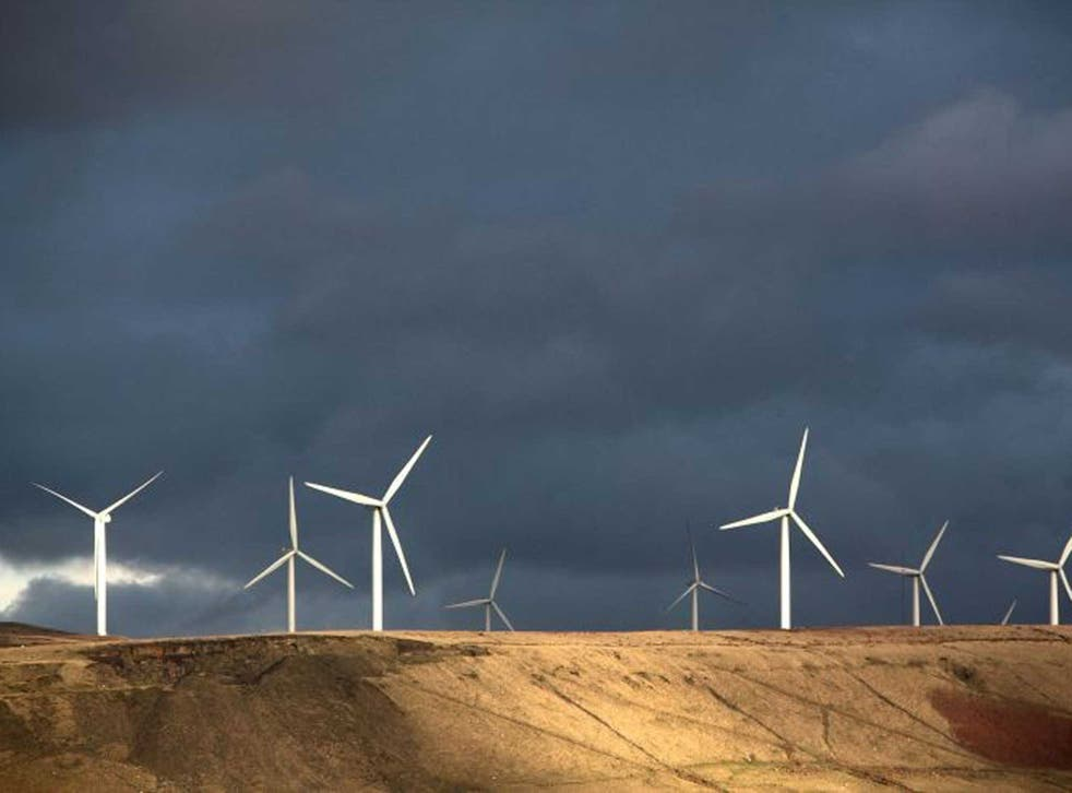 The turbine sails of the Scout Moor Wind Farm in the Pennines dominate the skyline