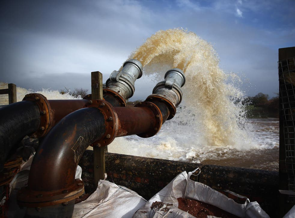 Flood water is seen pumped into the river at the pumping station near Fordgate on the Somerset Levels near Bridgwater