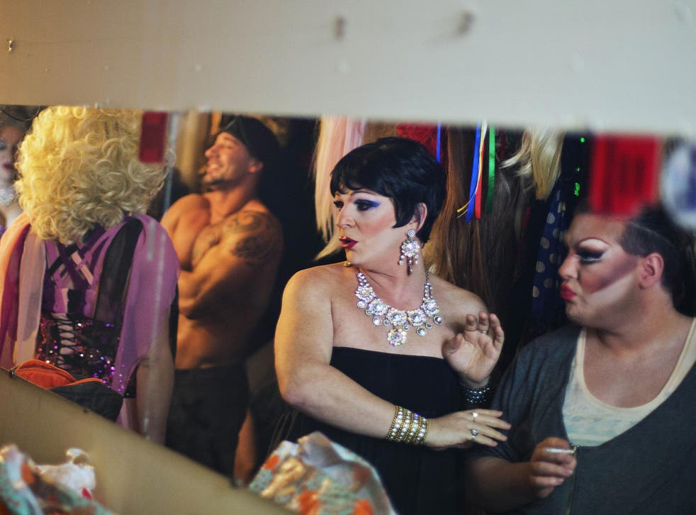 Two performers get ready to go on stage at the Mayak cabaret, the most reputable gay club in Sochi, Russia