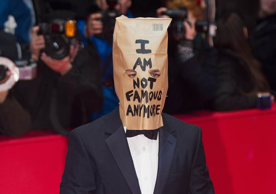 Shia LaBeouf wears a paper bag on his head to the premiere of ...