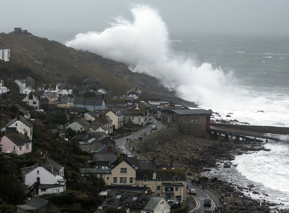 """Storm waves break at Sennen on 8 February, 2014 in Cornwall, England. The Met Office's chief scientist has now warned that the """"persistent"""" storms may be linked to climate change."""
