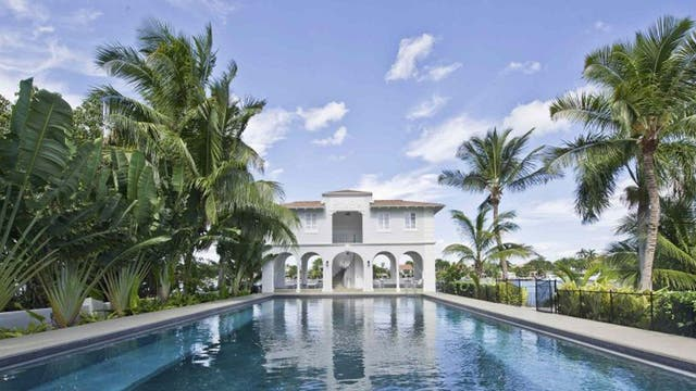 The pool house and pool of the waterfront mansion on Palm Island in Miami Beach, once owned by notorious gangster Al Capone