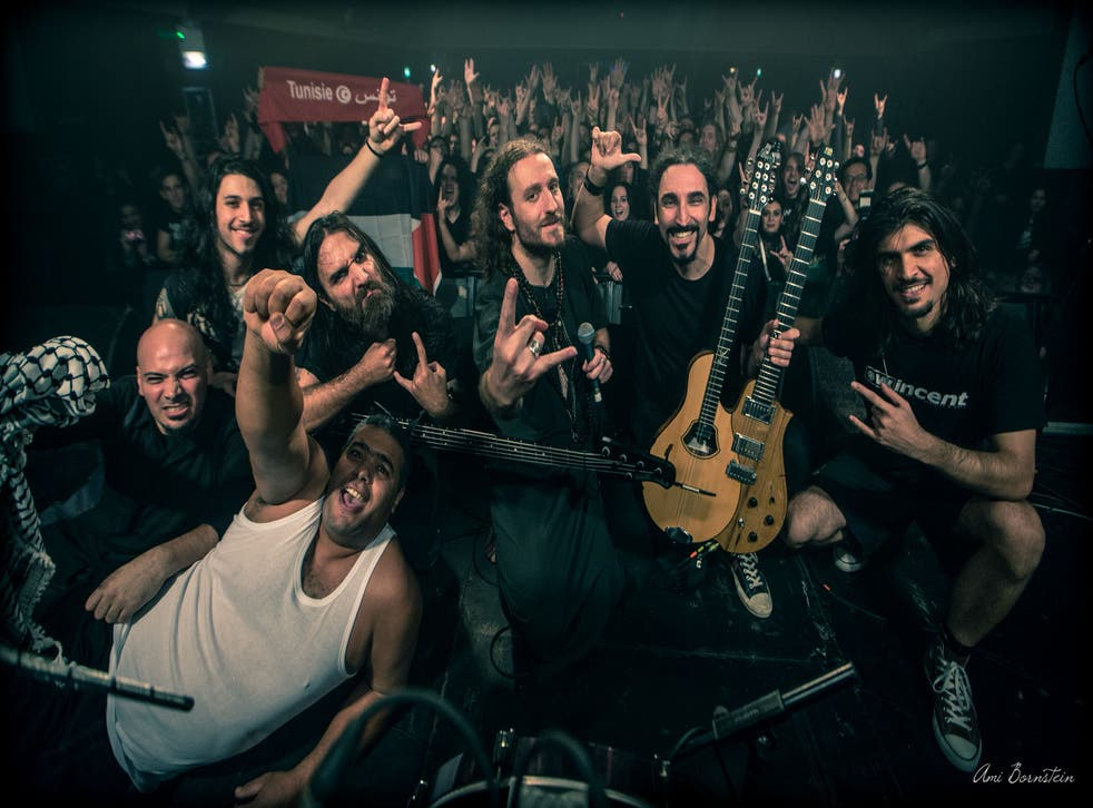 Head-banging for peace: Abed (far left) of Palestinian band Khalas and Kobi (third from right) of Israeli band Orphaned Land
