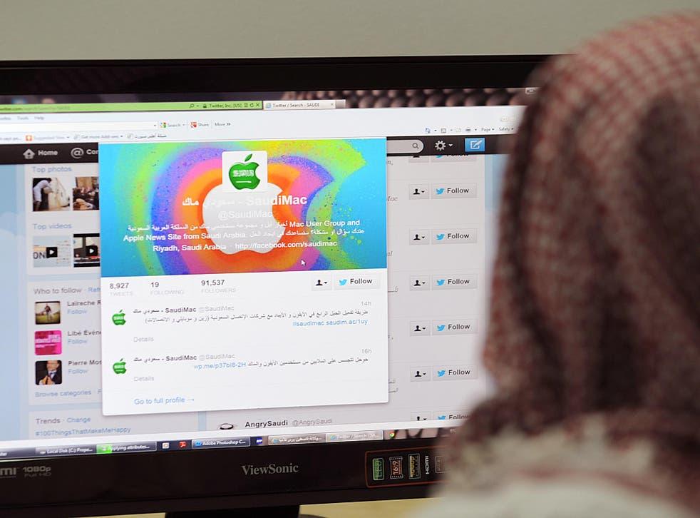 A Saudi man browses through twitter on his desktop in Riyadh, Saudi Arabia