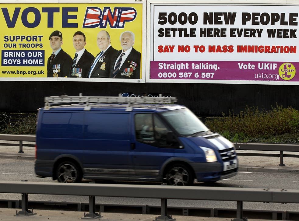 A van drives past posters encouraging voters to support the British National Party (BNP) and the UK Independence Party (UKIP) in Newham on April 10, 2010 in London, England. BNP leader Nick Griffin is attempting to unseat the Labour MP Margaret Hodge in t