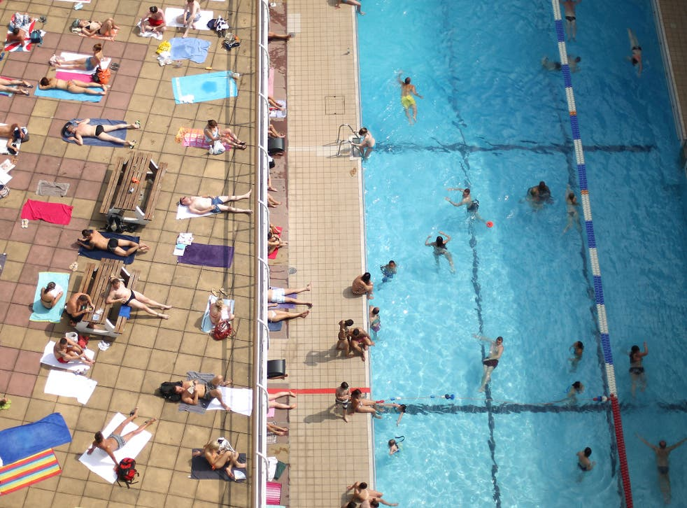 Swimmers enjoy the sunshine at an outdoor pool in central London on July 17, 2013 in England. The United Kingdom is experiencing heatwave conditions for a second week.
