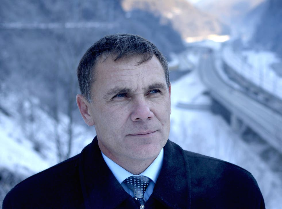 Environmental Watch ecology group activist Yevgeny Vitishko stands in front of the new road between Adler and Krasnaya Polyana in the Black Sea resort of Sochi