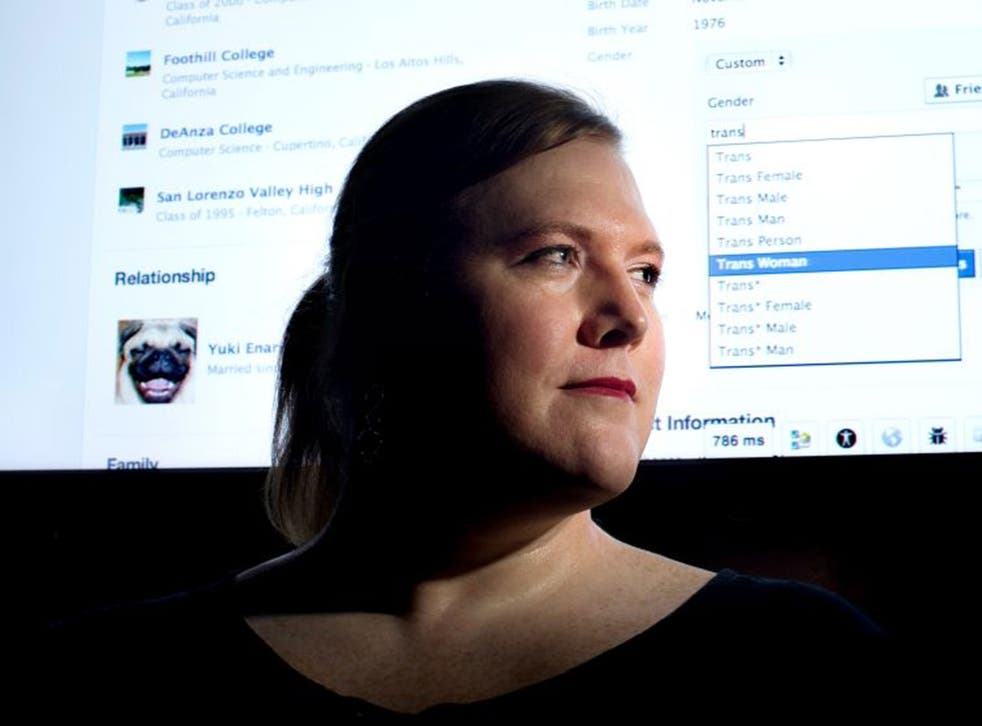 """Facebook software engineer Brielle Harrison demonstrates Facebook's expanded options for gender identification at her company's headquarters.  Harrison plans to switch her identifier to """"Trans Woman."""""""
