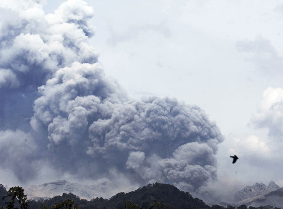 Mount Kelud erupts, as seen from Anyar village in Blitar, East Java, Indonesia, Friday, 14 Feb 2014.