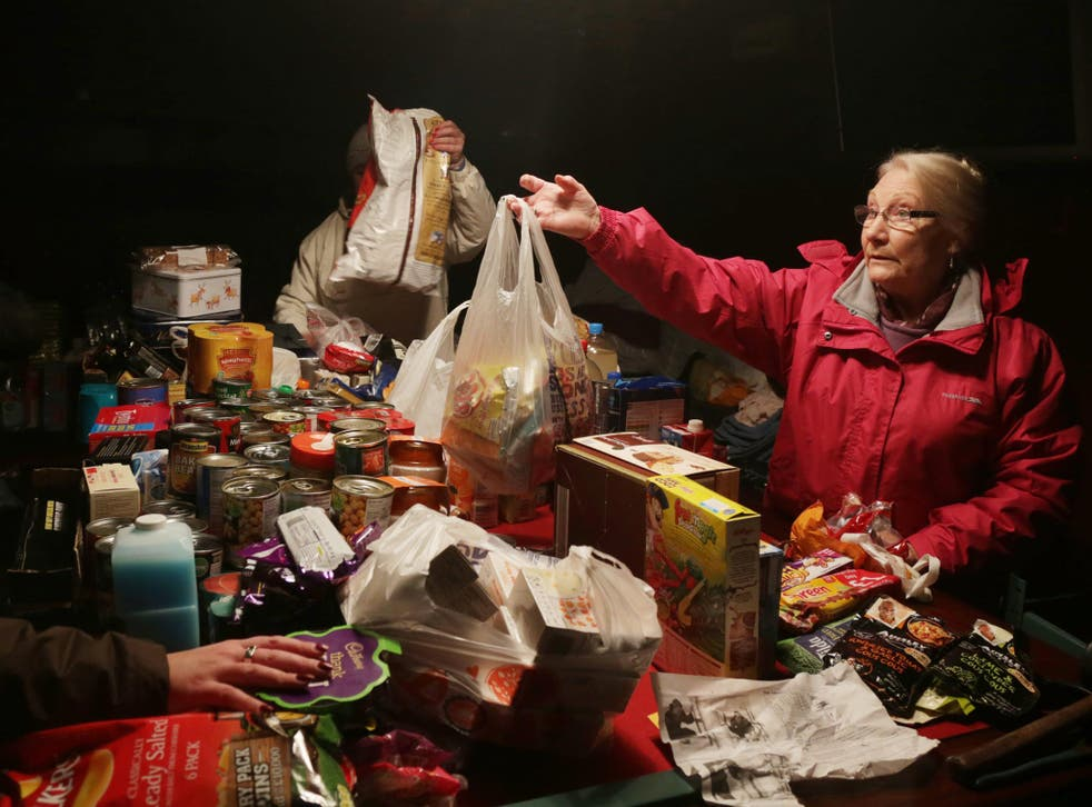 Volunteers sort out food donations in the King Alfred Inn at Burrowbridge on the Somerset Levels