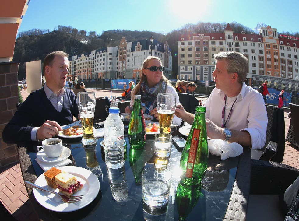 Visitors enjoy the sun at Rosa Khutor village near the mountain cluster