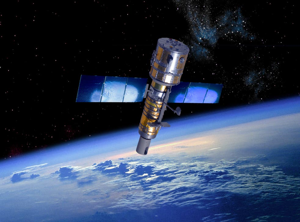 An artist's rendition of a military reconnaissance satellite in orbit above the Earth