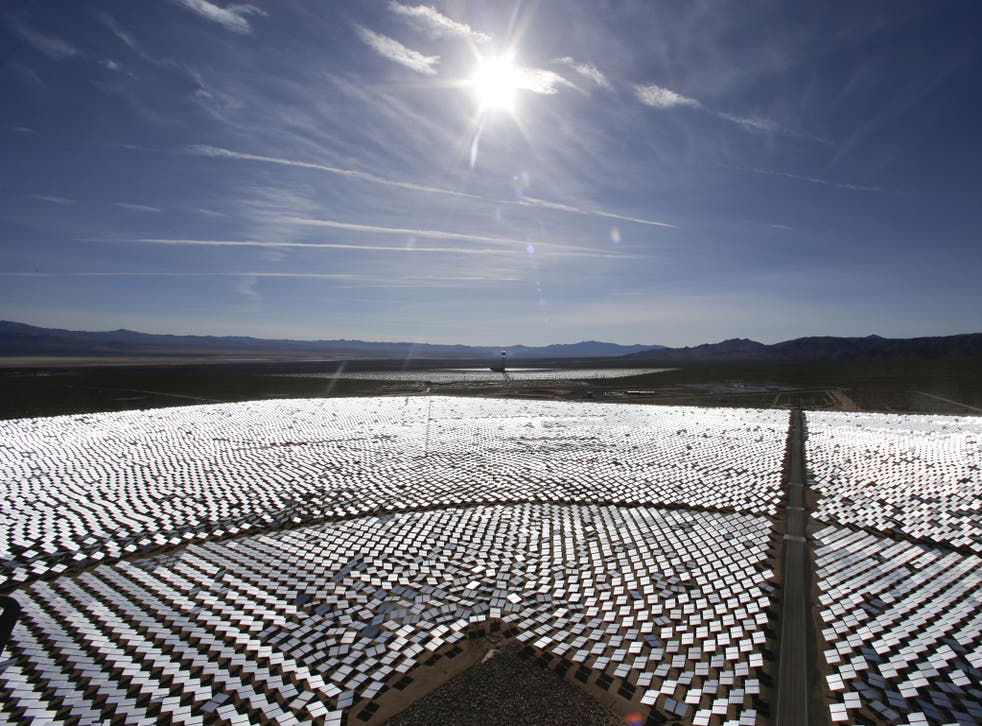 Some of Ivanpah's 300,000 computer-controlled mirrors, each about 7 feet high and 10 feet wide, reflect sunlight to boilers that sit on 459-foot towers
