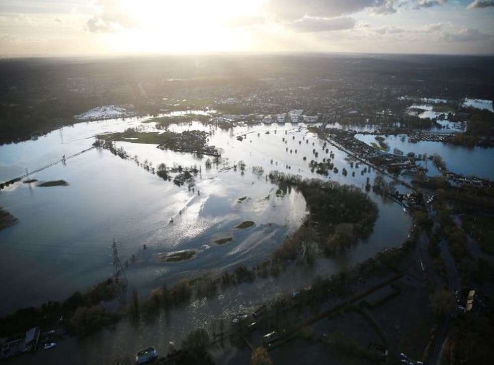 Flood water spills from the river Thames on Sunday in Chertsey, England.