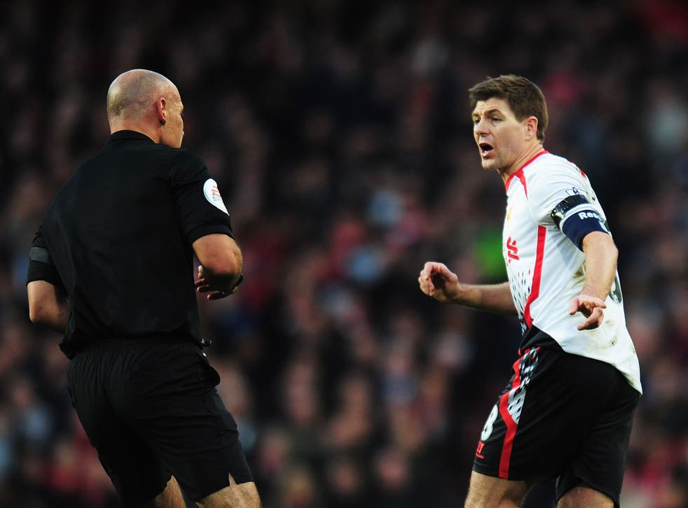 Steven Gerrard protests to referee Howard Webb over his failure to award a penalty for Alex Oxlade-Chamberlain's challenge on Luis Suarez
