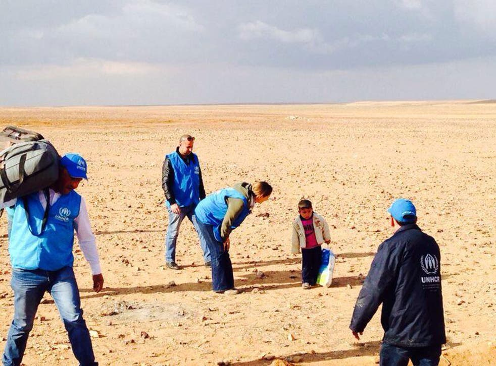 This extraordinary image showing four-year-old Syrian refugee Marwan being assisted by UNHCR officials was seized upon and shared around the world via social media