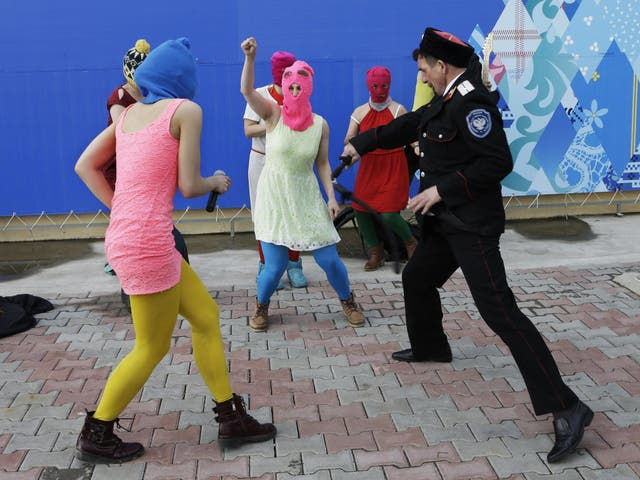 Members of the punk group Pussy Riot are attacked with whips in Sochi on Wednesday