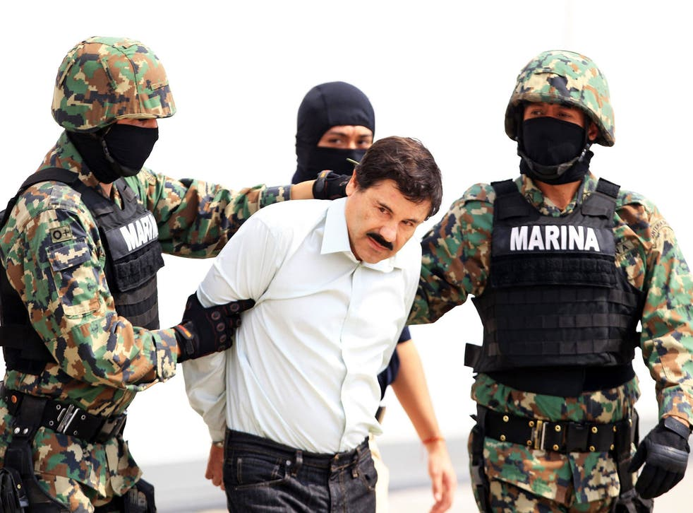 Mexican military hold drug lord Joaquin Guzman, also known as 'El Chapo' in Mexico City, 22 February 2014