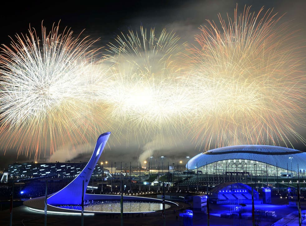 Fireworks explode around the Fisht Olympic Stadium at the end of the Closing Ceremony of the Sochi Winter Olympics at the Olympic Park in Sochi