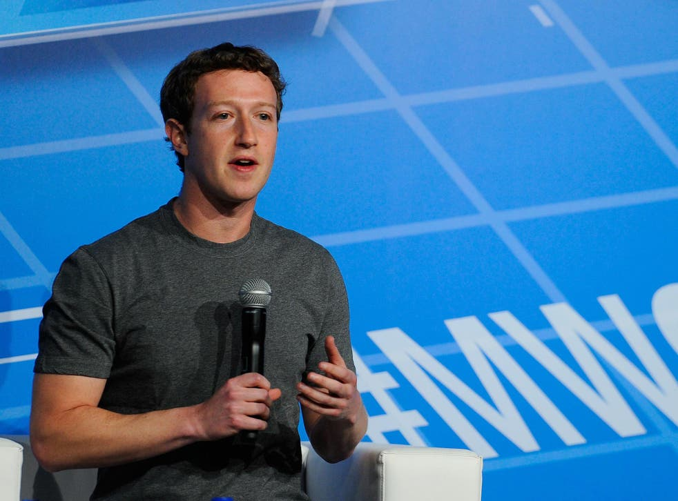 Co-Founder, Chairman and CEO of Facebook Mark Zuckerberg  speaks during his keynote conference at the Mobile World Congress 2014