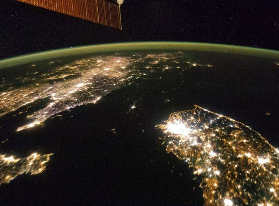 North Korea appears as a black expanse of sea between neighbouring China (left) and South Korea (right)