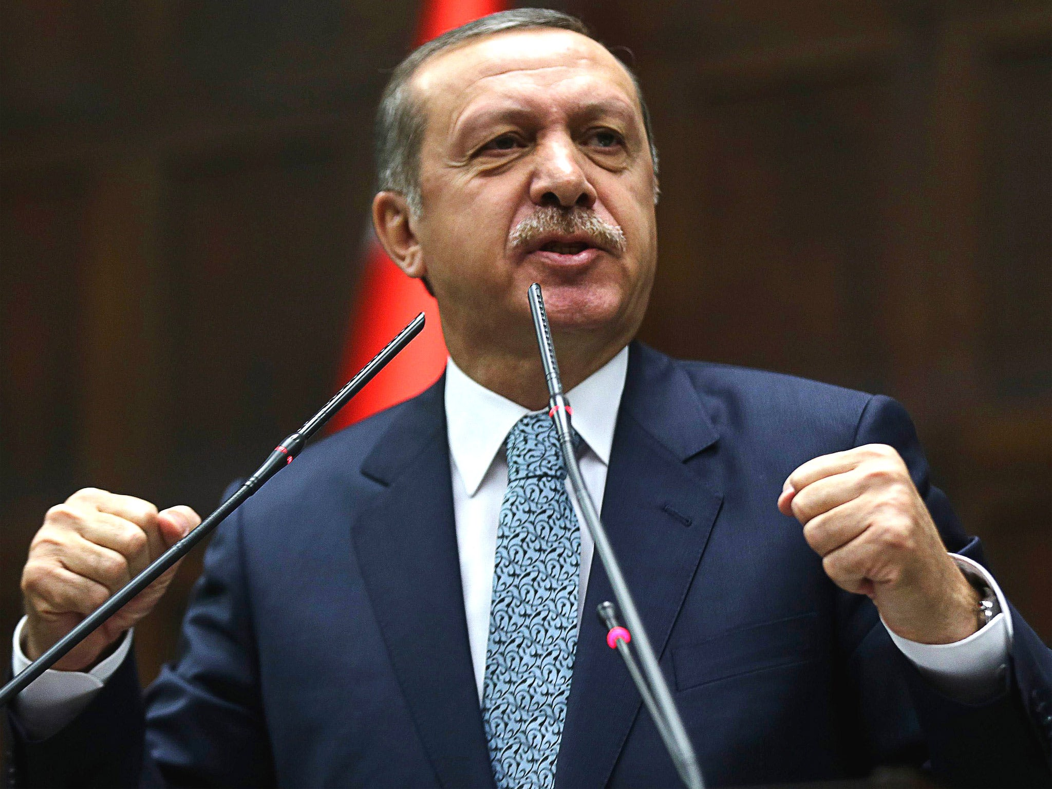 Turkish PM, Recep Tayyip Erdogan, claims incriminating audio tape of him allegedly discussing ways to smuggle cash out of the country is a fake