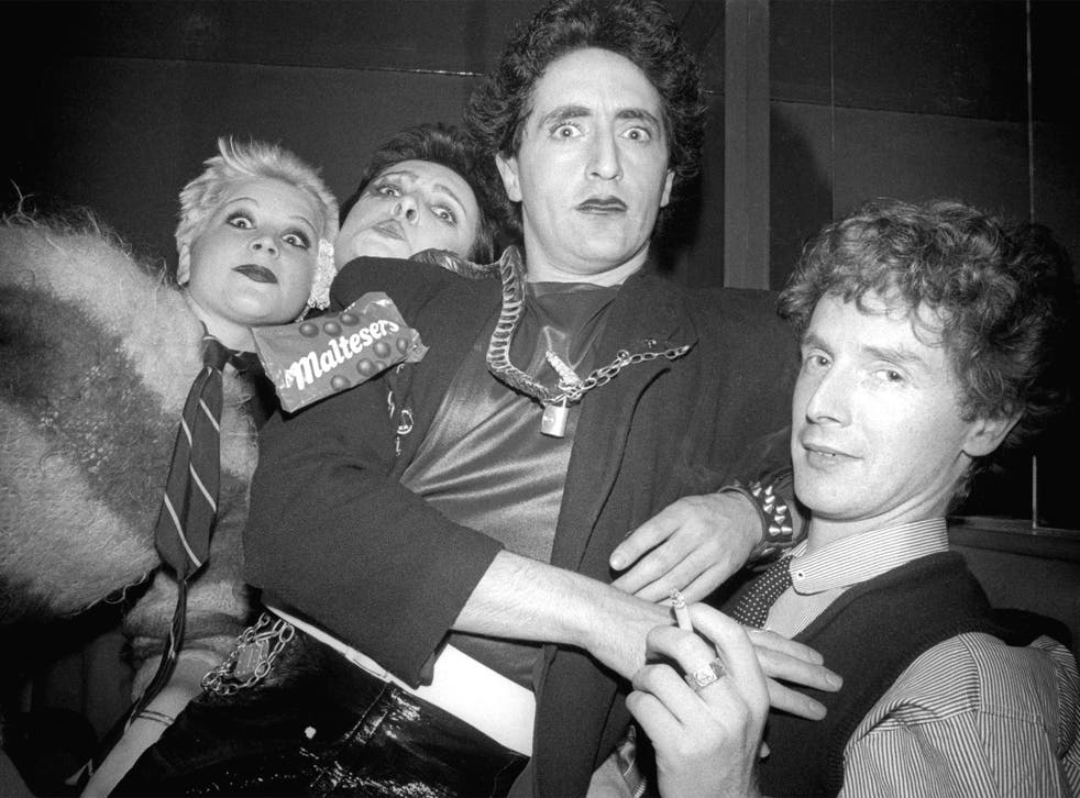 Malcolm McLaren (right) with Pistols fans including Siouxsie Sioux (second left) in 1976
