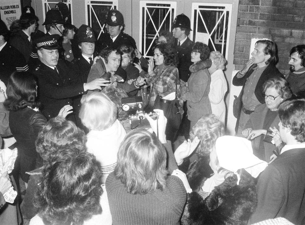 Police and protesters at PIE's first open meeting in London in 1977