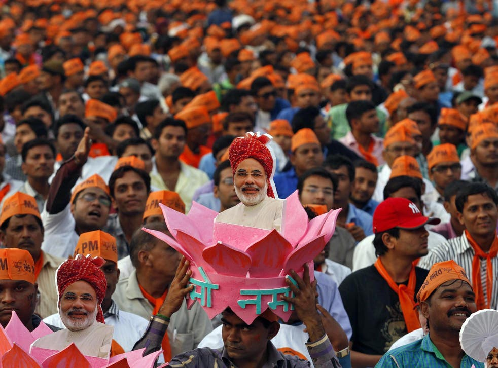 A supporter of Gujarat's chief minister and Hindu nationalist Narendra Modi, the prime ministerial candidate for India's main opposition Bharatiya Janata Party (BJP), wears a headgear with a portrait