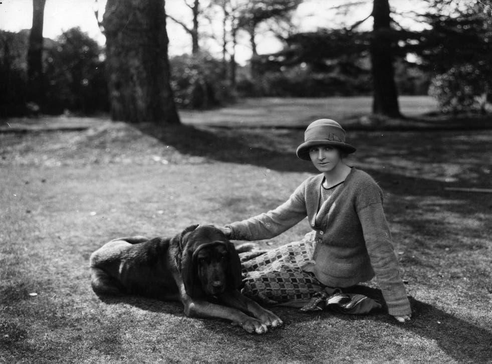 English novelist Rose Macaulay with her bloodhound