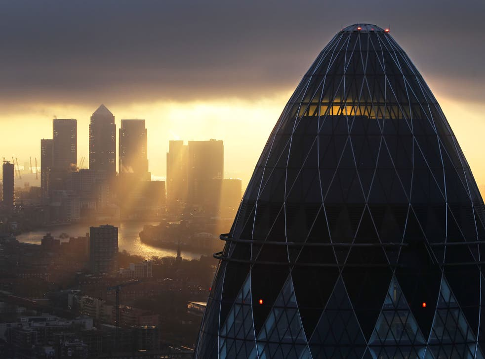 Sun rises over the City of London on February 25, 2010 in London