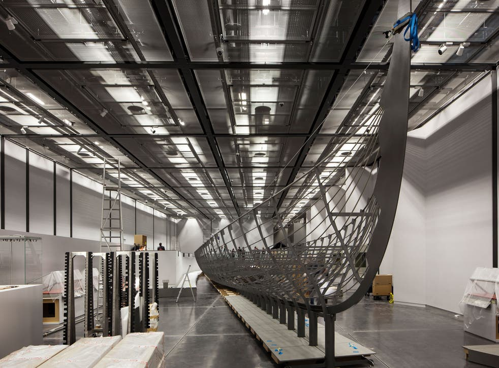 'Roskilde 6' being installed at the British Museum. The keel measures 32m long, and it has been estimated that there would have been about 78 oarsmen powering the boat along