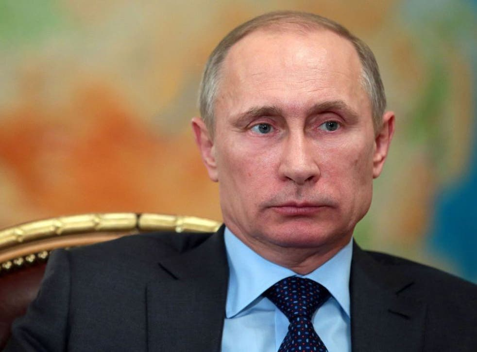 Russia's President Vladimir Putin attends a meeting in his Novo-Ogaryovo residence