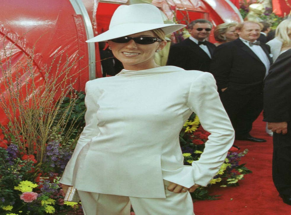 Canadian singer Celine Dion made a bold fashion statement at the 71st Academy Awards, deciding to wear her white Christian Dior tuxedo backwards with a matching fedora and diamond-encrusted sunglasses.