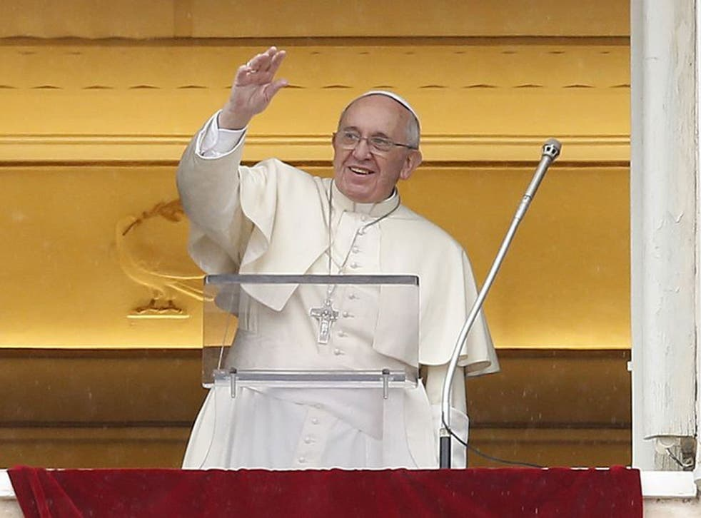 Pope Francis greets the crowd during his Sunday address