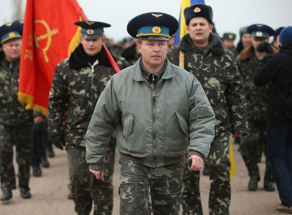 Colonel Yuli Mamchor, commander of the Ukrainian military garrison at the Belbek airbase, leads his unarmed troops in a bid to retake Belbek airfield