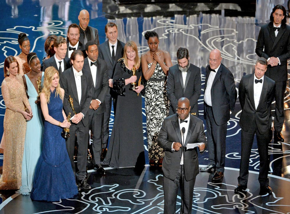 '12 Years A Slave' director Steve McQueen accepts his award for Best Picture at the Oscars. Screenwriter John Ridley can be seen at the very back, behind actor Chiwetel Ejiofor