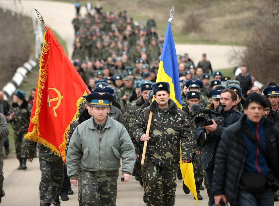 Colonel Yuli Mamchor, commander of the Ukrainian military garrison at the Belbek airbase, leads his unarmed troops to retake the Belbek airfield from soldiers under Russian command in Crimea