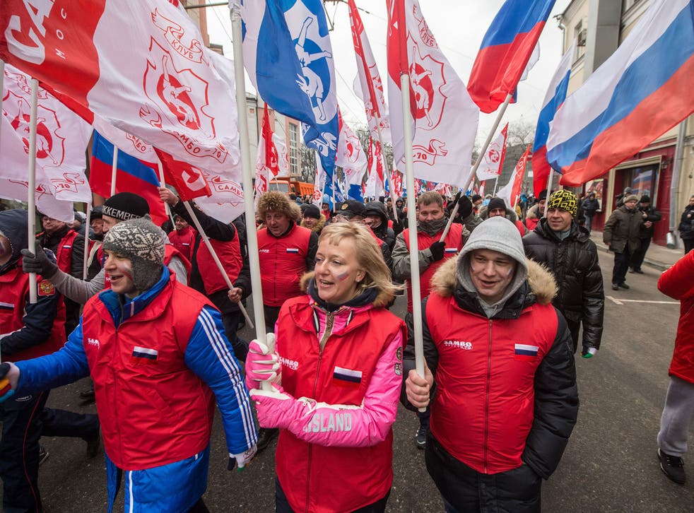 Pro-Kremlin activists march during a rally in support of ethnic Russians in Ukraine in central Moscow, March 2, 2014.