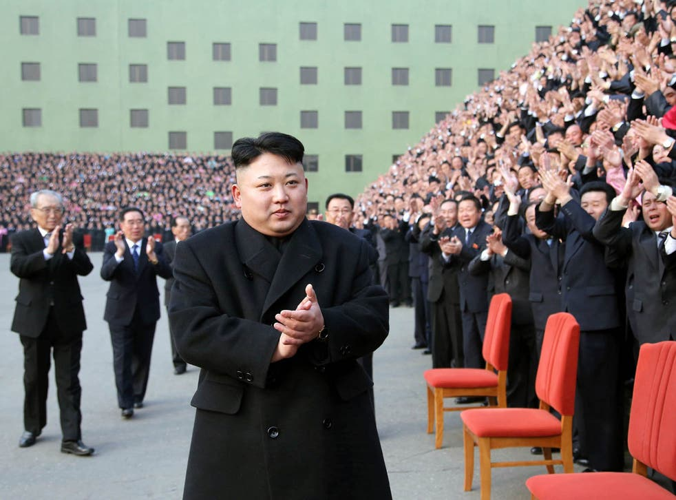 Kim Jong-Un  reacts to participants of the 8th conference of the ideological officials of the Workers Party of Korea (WPK) in Pyongyang