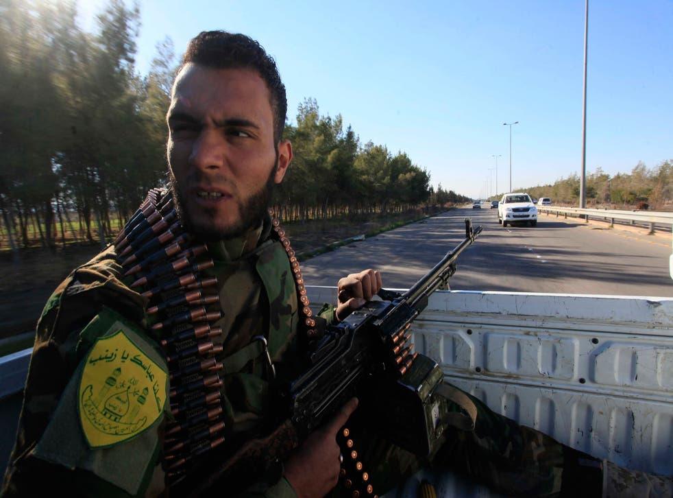 An Iraqi Shiite fighter patrols the outskirts of Damascus