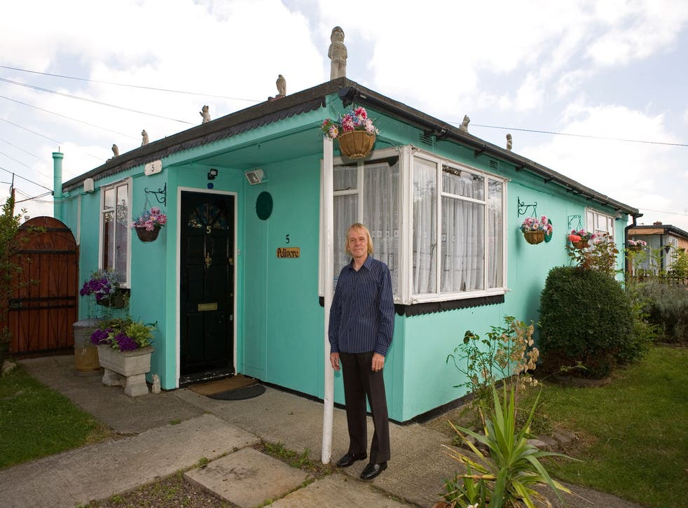Jim Blackender, pictured in front of his prefab in July 2009, was the leader of a fight to save the prefabs from demolition. He now lives in Kent; his prefab home is now boarded up