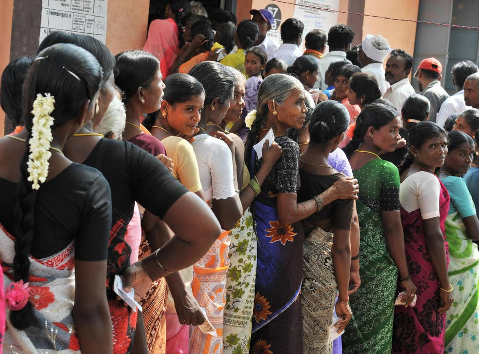 Indian women queue outside an election polling booth. Just under 390 million women are registered to vote in the coming general election