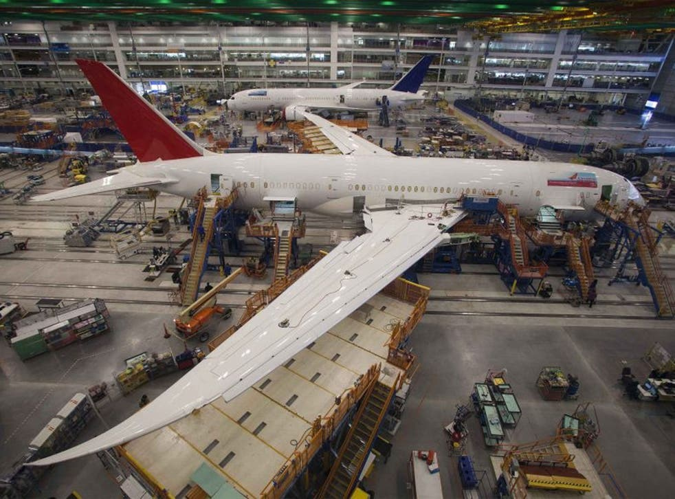 """Workers at South Carolina Boeing work on a 787 Dreamliner for Air India at the plant's final assembly building in North Charleston, South Carolina in this December 19, 2013 file photo. Boeing Co said March 7, 2014 that """"hairline cracks"""" had been discovere"""