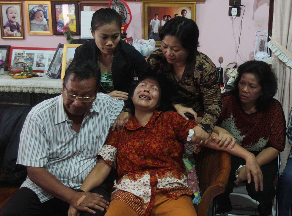 The parents of Firman Chandra Siregar, one of the passengers on flight MH370 in Medan, Indonesia