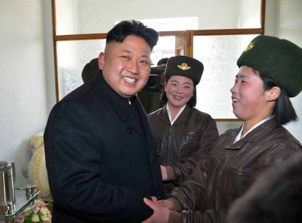 North Korea leader Kim Jong-un, pictured with pilots this month, is accused of human rights abuses