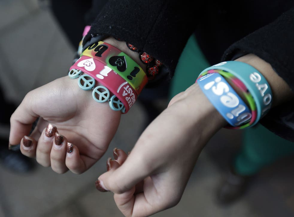 Easton Area School District student Kayla Martinez displays her bracelets for photographers outside the U.S. Courthouse in Philadelphia