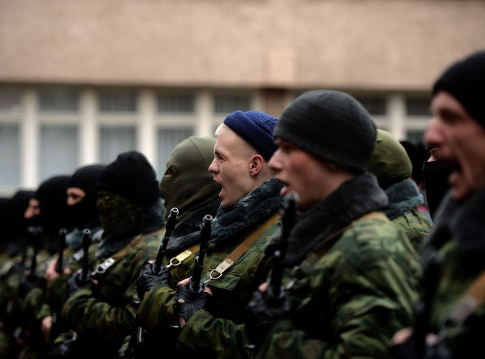 """Pro-Russian forces dubbed the """"military forces of the autonomous republic of Crimea"""" attend their swearing-in ceremony"""