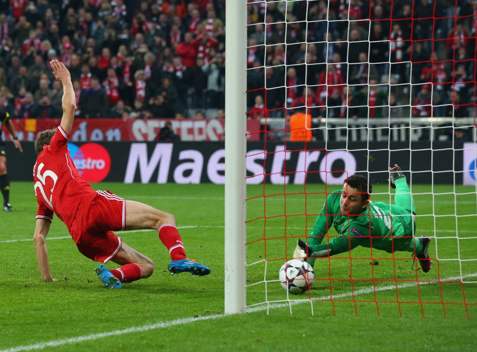 Lukasz Fabianski, keeper of Arsenal saves a penalty by Thomas Mueller