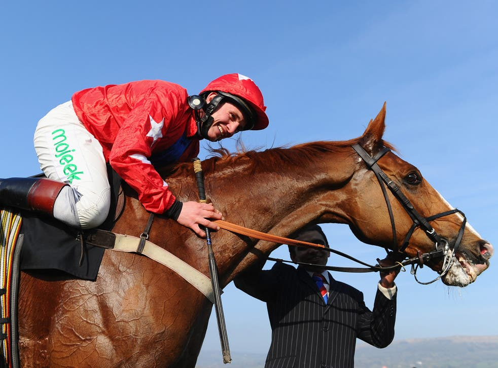 Jamie Moore and Sire de Grugy celebrate victory in the BetVictor Queen Mother Champion Chase during Ladies Day at Cheltenham Festival